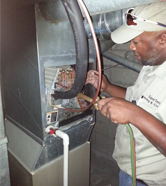 Technician Working on Heater - Air Conditioning Services